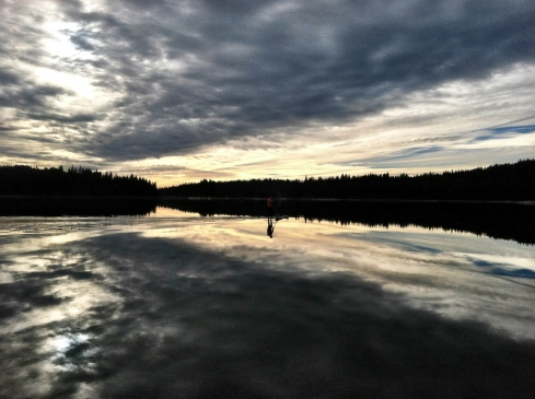 A paddle boarder makes his way across Jenkinson Lake. ©Tracy J. Thomas, 2012. All rights reserved.