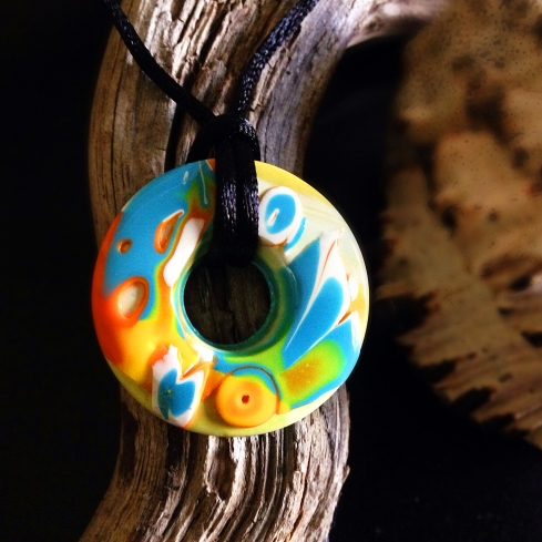 Coral Reef - Mokume Gane Polymer clay doughnut pendant on satin cord. Listed on my Etsy store.